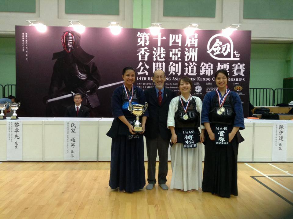 IGA Ken Women's Team A accepting their trophy from Lai-Sensei (HKKA President)